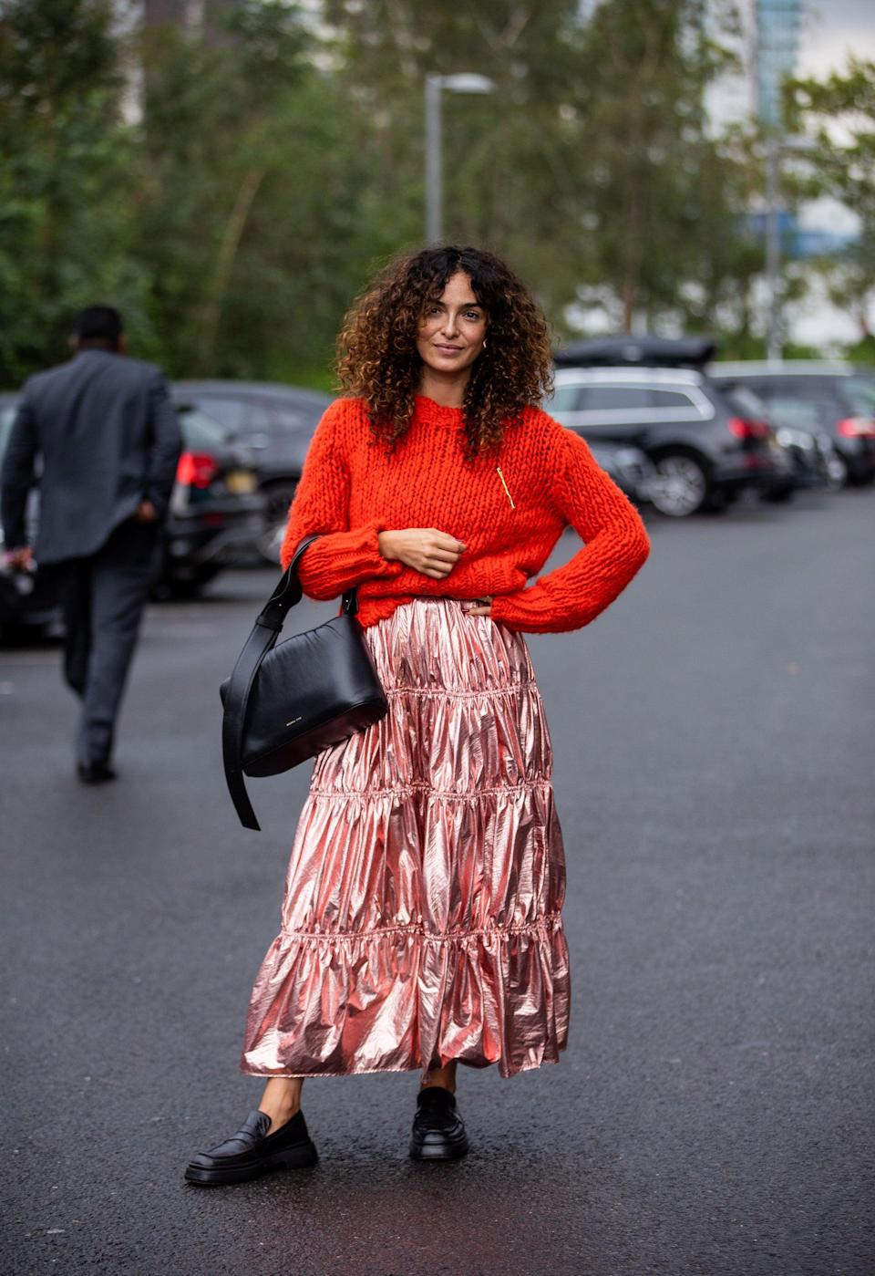 """We love the balance of cosy knit with '80s wrapping-paper fabulous skirt.<span class=""""copyright"""">Photo Courtesy of Christian Vierig/Getty Images. </span>"""
