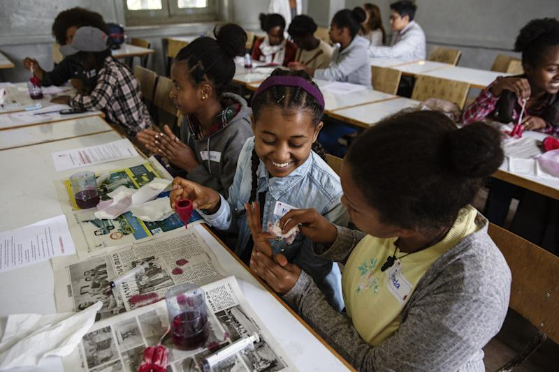 Girls learn about menstrual cups at a Noble Cup workshop