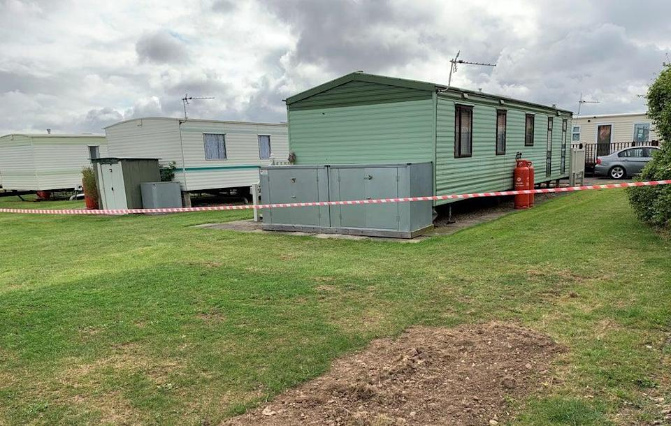 Caravans in the surrounding area were taped off by police on Tuesday (Josh Payne/PA) (PA Wire)