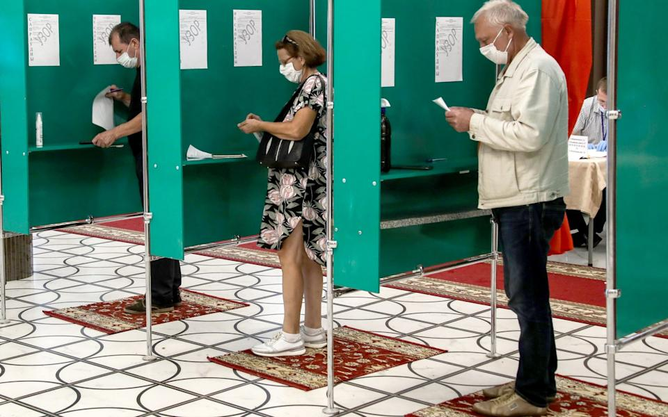 People vote at a polling station during the 2020 Belarusian presidential election - Tass