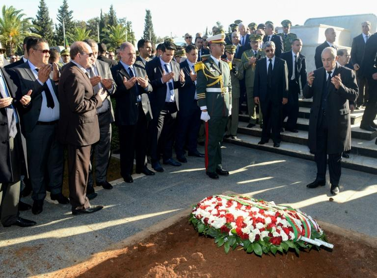 President Abdelmadjid Tebboune prayed at the grave of Gaid Salah in Al-Alia cemetery in Algiers after laying a wreath (AFP Photo/MAMECHE ABDELKADER)