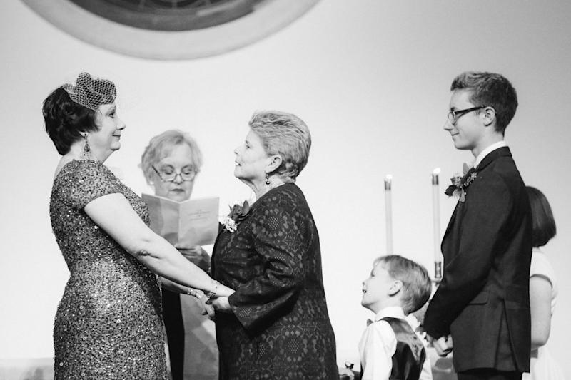 """Karen and Becky planned a Christmas wedding at their church where they were finally able to marry after a decades-long romance. I cried behind my camera during the entire ceremony and a guest towards the back of the church offered me tissues."" -- <i>Leah Moyers </i>"