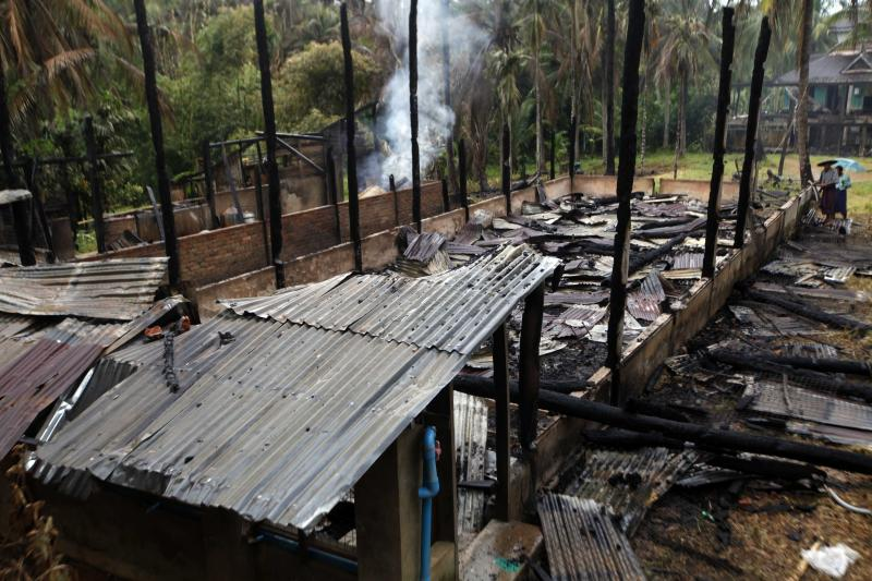 Smoke rises from debris of a burnt mosque which was torched during Tuesday's clashes between Buddhists and Muslims in Thabyuchaing village, Thandwe township, Rakhine State, in western Myanmar, Thursday, Oct. 3, 2013. Rakhine was home to much of the sectarian violence that has killed hundreds of people since June 2012. The violence has thrown new attention on the government's failure to stop the unrest, which has displaced more than 140,000 people, the majority of them Muslims in this heavily Buddhist country. (AP Photo/Khin Maung Win)