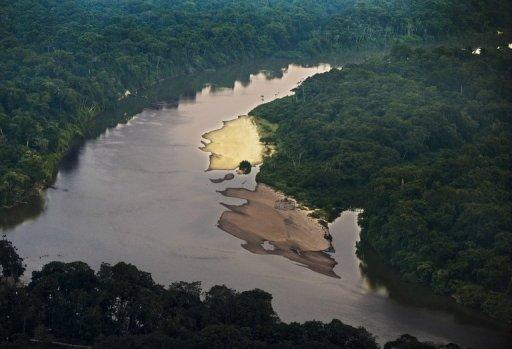 File picture shows an aerial view of the Novo river in the Amazon state of Para, northern Brazil. Brazil will boost its military presence in the Amazon region to protect its huge natural resources from any external threat, Defense Minister Celso Amorim told the Senate