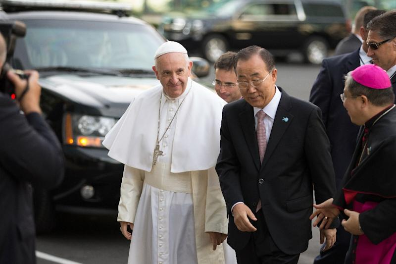 Pope Francis arrives at the United Nations headquarters with UN Secretary General Ban Ki-moon on September 25, 2015