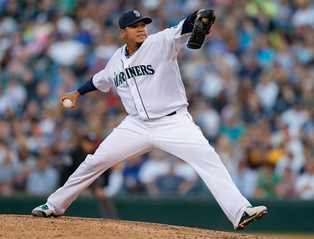 SEATTLE, WA - JULY 13: Starter Felix Hernandez #34 of the Seattle Mariners pitches against the Los Angeles Angels of Anaheim at Safeco Field on July 13, 2013 in Seattle, Washington. (Photo by Otto Greule Jr/Getty Images)