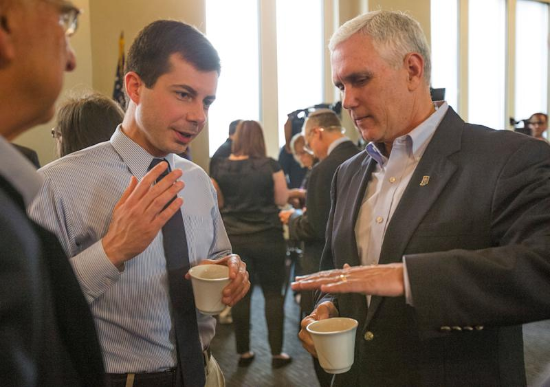 Pete Buttigieg, left, with Mike Pence