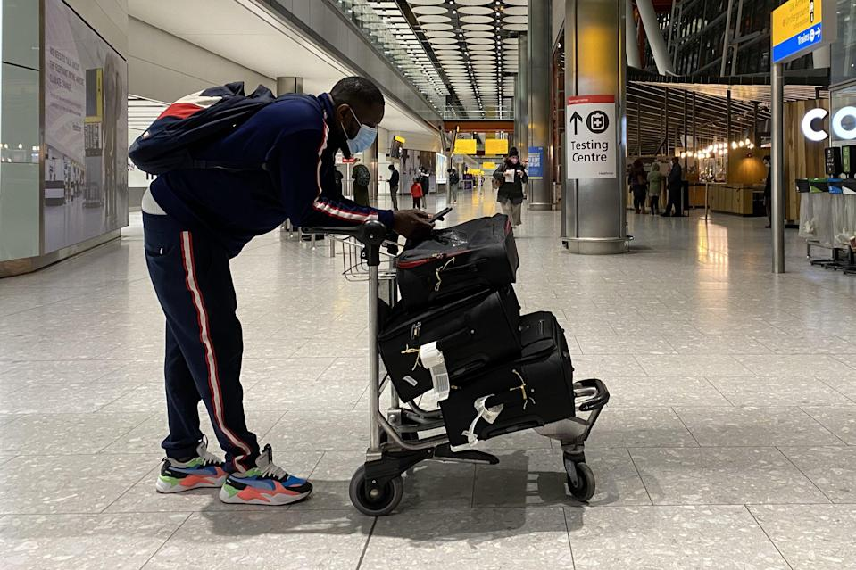 A passenger at Heathrow Airport (PA Wire)