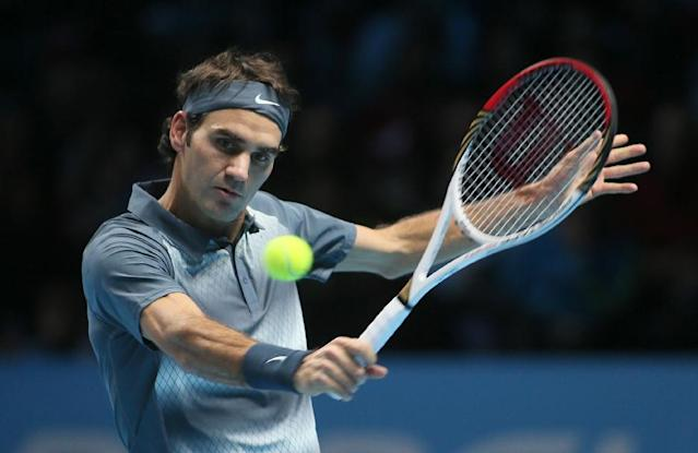 Roger Federer of Switzerland plays a return to Rafael Nadal of Spain during their ATP world Tour Finals tennis semifinal match at the O2 Arena on London, Sunday, Nov. 10, 2013. (AP Photo/Alastair Grant)