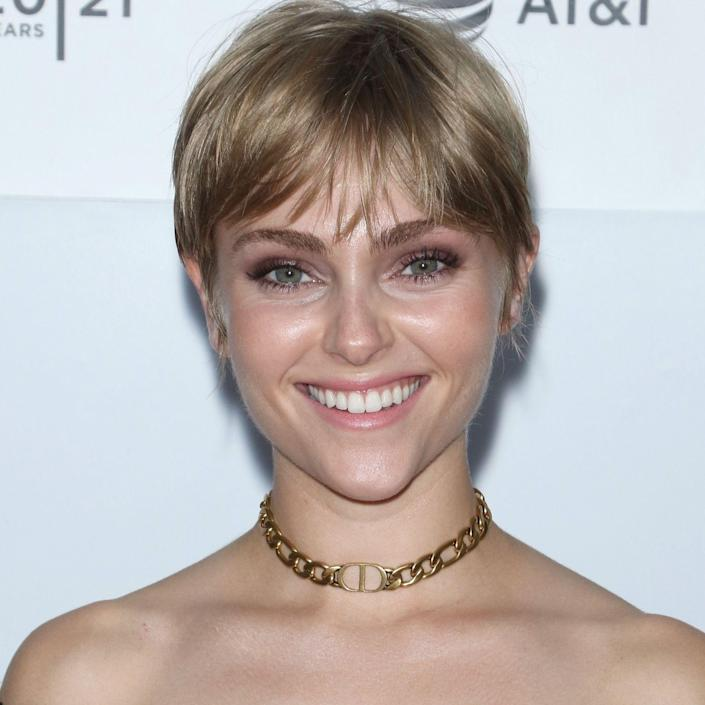 """You might not think that color can actually make a big difference to the overall texture of your hair, but think again. """"AnnaSophia Robb's dark blonde hair works well for her because of her straight and fine texture,"""" explains Gibson. """"By keeping a darker blonde look it makes her hair look fuller and her eyes pop more."""" Plus, her new pixie cut gives her whole look a unique and modern feel."""