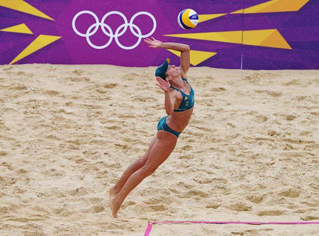 LONDON, ENGLAND - JULY 29: Becchara Palmer of Australia serves during Women's Beach Volleyball Preliminary match between Germany and Australia on Day 2 of the London 2012 Olympic Games at Horse Guards Parade on July 29, 2012 in London, England. (Photo by Ryan Pierse/Getty Images)