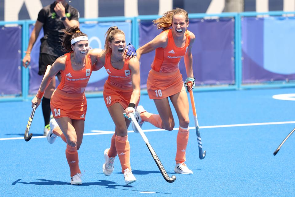 TOKYO, JAPAN - AUGUST 04: Eva Roma Maria de Goede, Pien Sanders and Felice Albers of Team Netherlands celebrate the fifth goal scored during the Women's Semifinal match between Netherlands and Great Britain on day twelve of the Tokyo 2020 Olympic Games at Oi Hockey Stadium on August 04, 2021 in Tokyo, Japan. (Photo by Alexander Hassenstein/Getty Images)