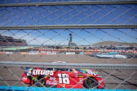 Mar 10, 2019; Avondale, AZ, USA; Monster Energy NASCAR Cup Series driver Kyle Busch (18) races during the TicketGuardian 500 at ISM Raceway. Mandatory Credit: Allan Henry-USA TODAY Sports
