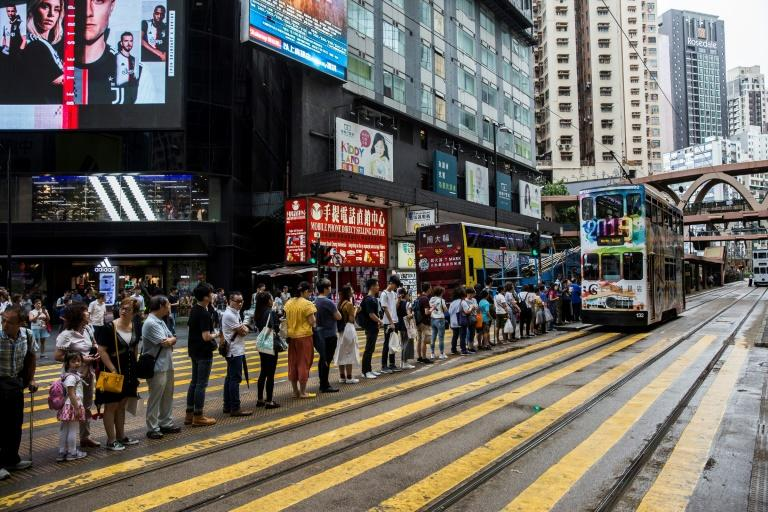 Hong Kong activists held up trains on the city's subway system during rush hour, leading to lengthy delays and long queues for buses and trams