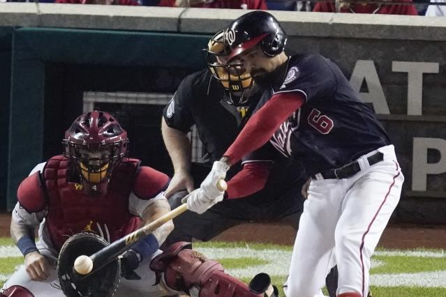 Washington Nationals' Anthony Rendon gets an RBI hit during the third inning of Game 3 of the baseball National League Championship Series against the Washington Nationals Monday, Oct. 14, 2019, in Washington. (AP Photo/Alex Brandon)