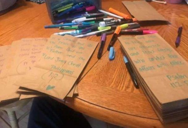 Wendy Reynolds writes messages on paper bags she uses for the sack lunches she gives to the homeless. (Wendy Reynolds)