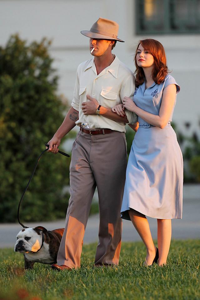 """The Help"" star Emma Stone and ""Blue Valentine"" hunk Ryan Gosling donned costumes from the 1940s as they shot a scene with an English bulldog for their upcoming flick ""Gangster Squad"" at the Griffith Observatory in Los Angeles on Tuesday. It's probably one of the few times Ryan and Emma have been photographed with someone cuter than they are! Clint Brewer/<a href=""http://www.splashnewsonline.com"" target=""new"">Splash News</a>"