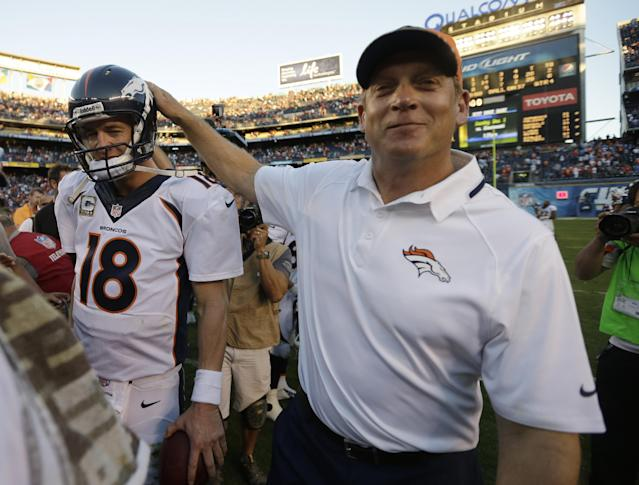 Denver Broncos quarterback Peyton Manning, left, and head coach Jack Del Rio, right, leave the field after beating the San Diego Chargers in an NFL football game Sunday, Nov. 10, 2013, in San Diego. The Broncos won, 28-20. (AP Photo/Gregory Bull)
