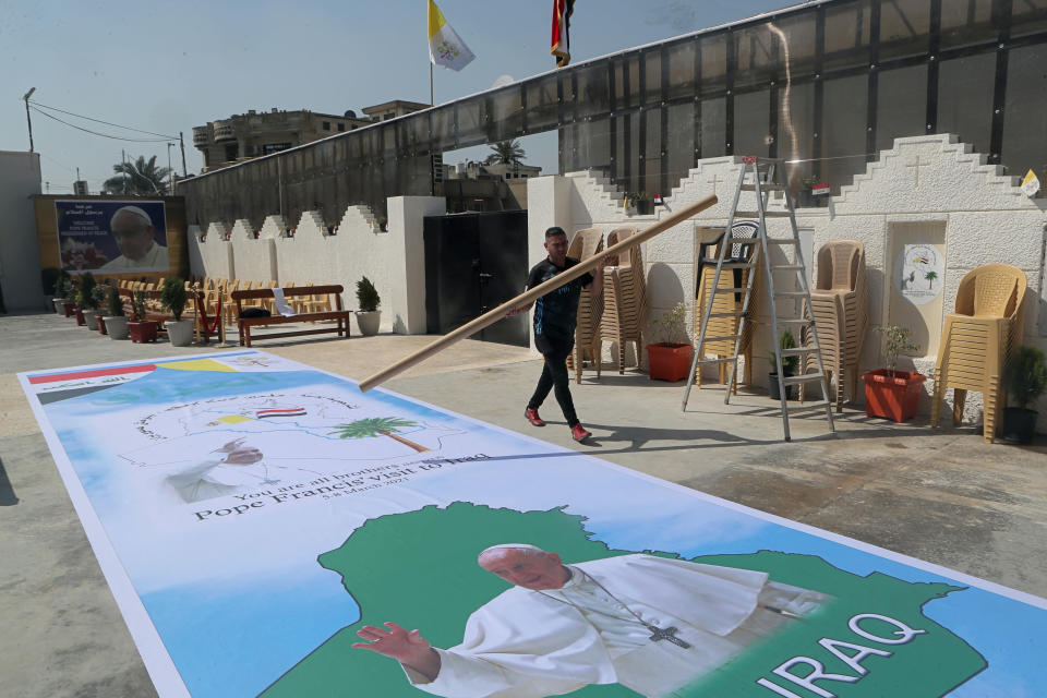 Posters welcoming Pope Francis are prepared at St. Joseph's Chaldean Church ahead of the Pope's visit, in Baghdad, Iraq, Tuesday, March 2, 2021. (AP/Photo/Khalid Mohammed)