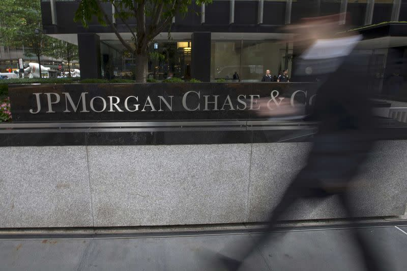 FILE PHOTO - People pass the JP Morgan Chase & Co. Corporate headquarters in the Manhattan borough of New York