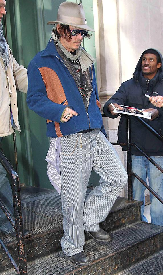 "Johnny Depp continued to confound as he left his New York City apartment in yet another hipster-railroad worker ensemble. The two-time ""Sexiest Man of the Year"" is looking a little rough around the edges, don't you think?"