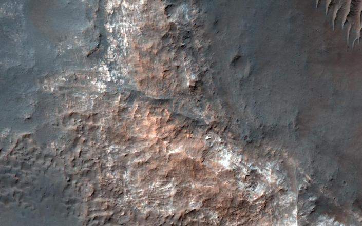 A photograph from NASA's Mars Reconnaissance Orbiter of Gorgonum Basin within the Red Planet's Terra Sirenum region, which scientists think once had a large lake (AFP Photo/Handout)