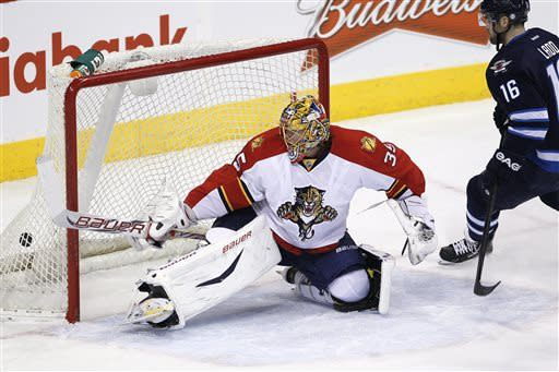 Winnipeg Jets' Andrew Ladd (16) scores on Florida Panthers goaltender Jacob Markstrom during the first period of their NHL hockey game in Winnipeg, Manitoba, Thursday, April 11, 2013. (AP Photo/The Canadian Press, John Woods)