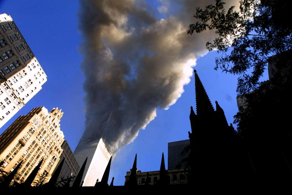 <p>Smoke spews from a tower of the World Trade Center on Sept. 11, 2001, after two hijacked airplanes hit the twin towers in a terrorist attack on New York City. (Photo: Mario Tama/Getty Images) </p>