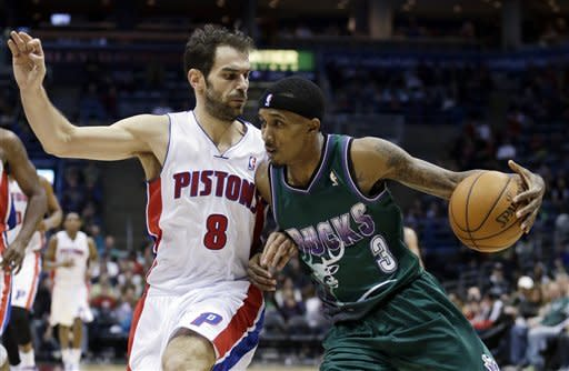 Milwaukee Bucks' Brandon Jennings (3) tries to drive past Detroit Pistons' Jose Calderon (8) during the second half of an NBA basketball game Saturday, Feb. 9, 2013, in Milwaukee. (AP Photo/Morry Gash)