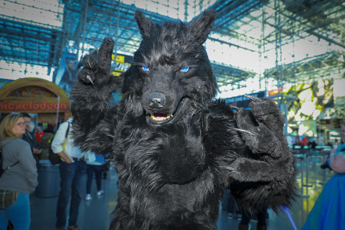 "A cosplayer dressed as the werewolf from the 1980's horror film ""The Howling"" arrives for the third day of the 2019 New York Comic Con at the Jacob Javits Center on Oct. 5, 2019. The four-day event is the largest pop culture event on the East Coast. (Photo: Gordon Donovan/Yahoo News)"