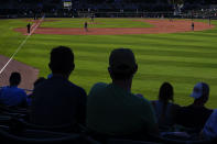 Baseball fans watch the Atlanta Braves and the Boston Red Sox play during a spring training baseball game on Monday, March 1, 2021, in Fort Myers, Fla. (AP Photo/Brynn Anderson)
