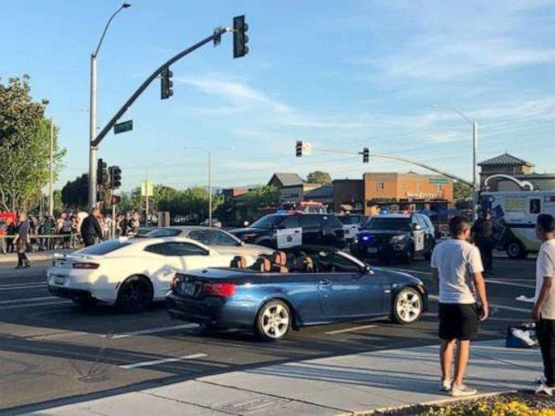 PHOTO: A woman who was hit by a driver in Sunnyvale, California, on April 23 was tossed in the air and landed right in front of the blue BMW convertible while it was stopped at an intersection, according to a witness. (Don Draper)