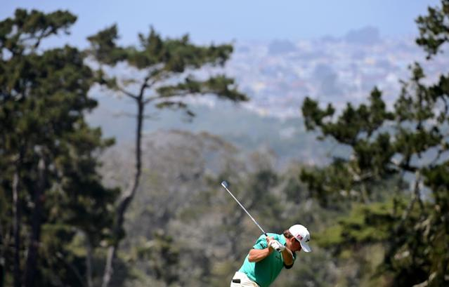 SAN FRANCISCO, CA - JUNE 14: Graeme McDowell of Northern Ireland hits a shot on the first hole during the first round of the 112th U.S. Open at The Olympic Club on June 14, 2012 in San Francisco, California. (Photo by Harry How/Getty Images)