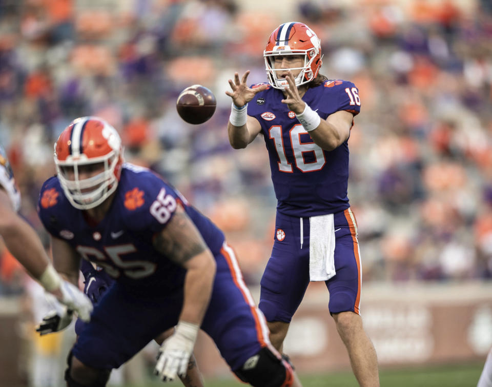 Clemson quarterback Trevor Lawrence (16) takes a snap during the first half of an NCAA college football game   against Pittsburgh Saturday, Nov. 28, 2020, in Clemson, S.C. (Ken Ruinard/The Independent-Mail via AP, Pool)
