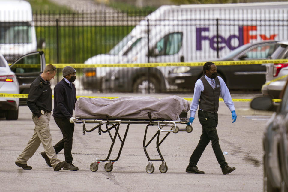 A body is taken from the scene where multiple people were shot at a FedEx Ground facility in Indianapolis.
