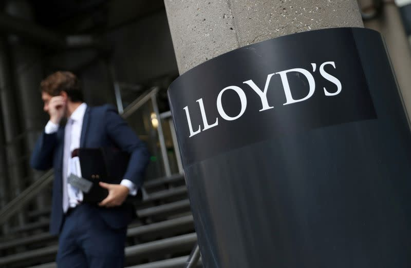 FILE PHOTO: A man walks out of Lloyd's of London's headquarters in the City of London