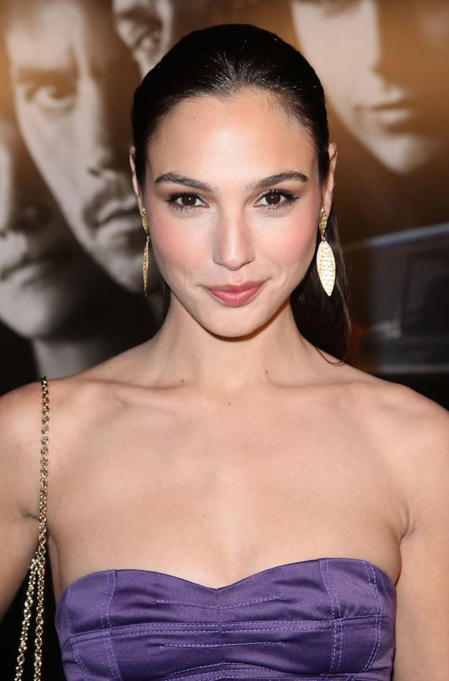<p>At Universal's premiere of the <em>Fast & Furious</em>, Gadot wears her hair in a sleek pony with a hint of cream blush on the cheeks and a taupe smoky eye. (2009)</p>