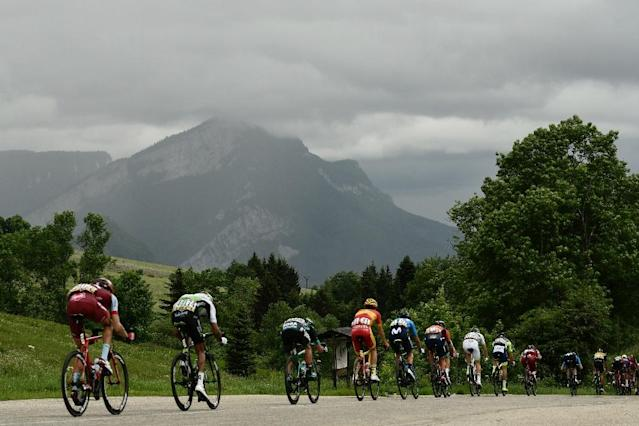 Quick Step's Julian Alaphilippe beat a bevvy of top drawer climb talent to win the fourth stage of the Criterium du Dauphine at a summit finish in lashing rain on Thursday (AFP Photo/Philippe LOPEZ)