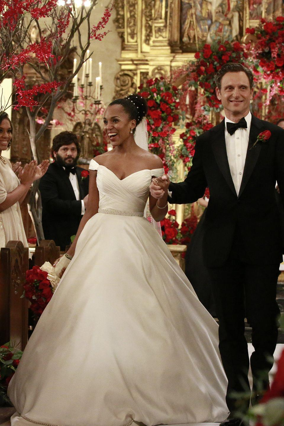 """<p>For those Fitz fans out there in the <em>Scandal</em> universe, this was probably a heartbreaking scene. This wedding sequence from season 6 aired as a """"what if"""" moment in which audiences saw what his marriage to Olivia could have looked like. In it, Olivia wore a shoulder-baring gown with a dramatic silk skirt, and her hair pulled back in an elegant rhinestone-embellished bun. </p>"""