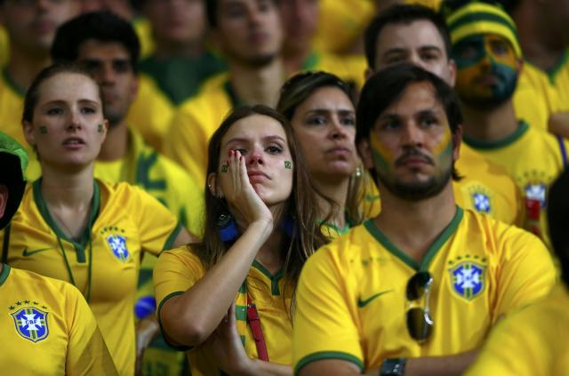 Brazil fans react during the 2014 World Cup semi-finals between Brazil and Germany at the Mineirao stadium in Belo Horizonte July 8, 2014. REUTERS/Eddie Keogh (BRAZIL - Tags: TPX IMAGES OF THE DAY SOCCER SPORT WORLD CUP)