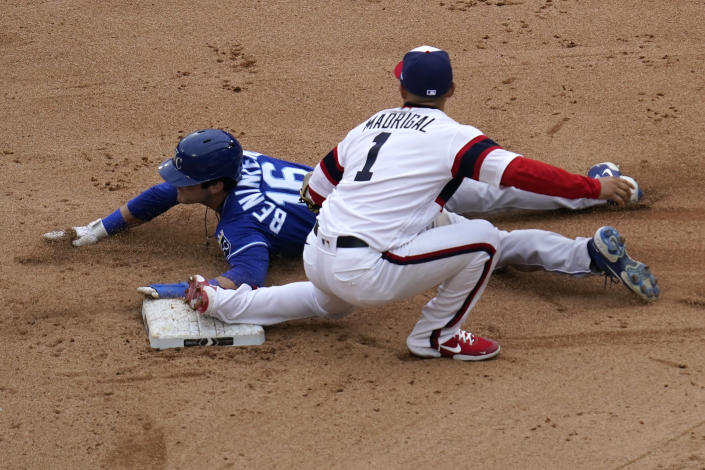 Chicago White Sox second baseman Nick Madrigal, right, tags out Kansas City Royals' Andrew Benintendi, left, at second during the eighth inning of a baseball game in Chicago, Sunday, April 11, 2021. (AP Photo/Nam Y. Huh)