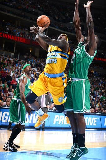 DENVER, CO - FEBRUARY 19: Ty Lawson #3 of the Denver Nuggets goes up for the shot against Jeff Green #8 of the Boston Celtics versus the Denver Nuggets on February 19, 2013 at the Pepsi Center in Denver, Colorado. (Photo by Garrett W. Ellwood/NBAE via Getty Images)