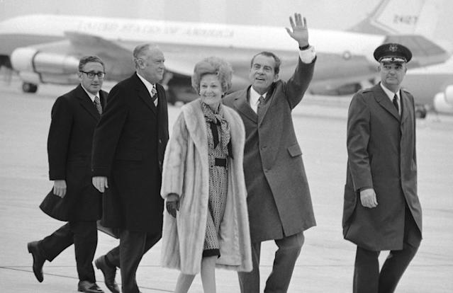 President Richard Nixon at Andrews Air Force Base near Washington on Feb. 17, 1972, leaving for his historic trip to China. Following him from the helicopter to Air Force One are first lady Pat Nixon, Secretary of State William P. Rogers and Dr. Henry A. Kissinger, left, the presidential adviser who first arranged the trip. (Photo: AP)