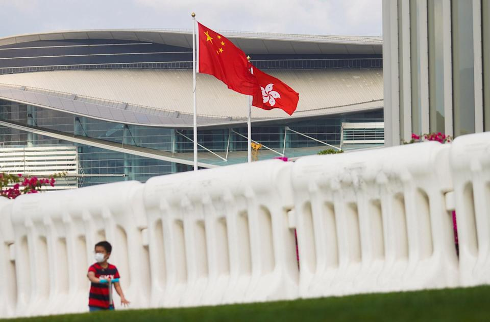 The Chinese and Hong Kong flags fly outside the Legislative Council. Photo: Winson Wong