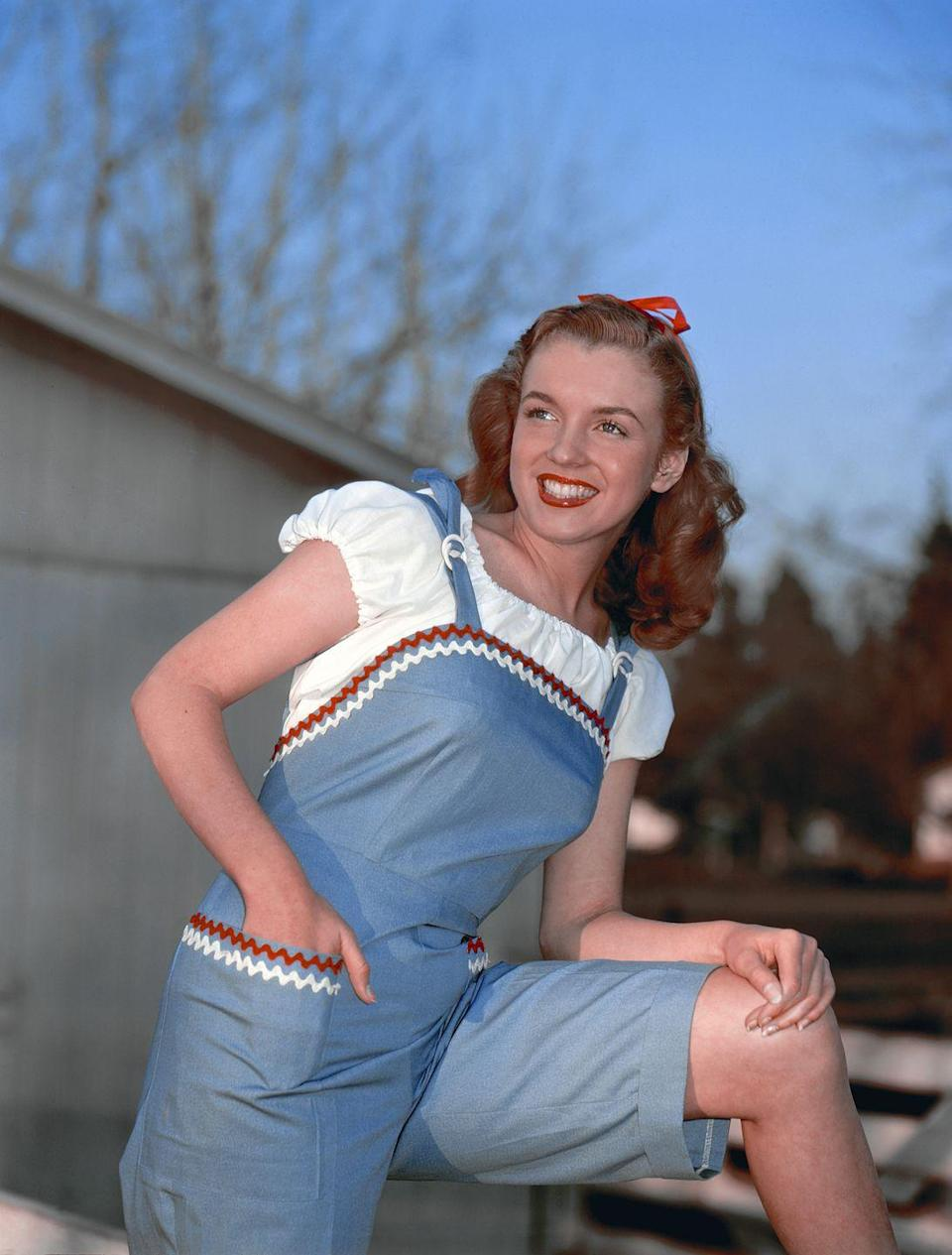 """<p><a href=""""https://time.com/5368339/marilyn-monroe-real-name-story/"""" rel=""""nofollow noopener"""" target=""""_blank"""" data-ylk=""""slk:Norma Jeane started going by Marilyn Monroe"""" class=""""link rapid-noclick-resp"""">Norma Jeane started going by Marilyn Monroe</a> this year, but according to <em>TIME Magazine</em>, it would be another 10 years before she officially changed her name. <br></p>"""