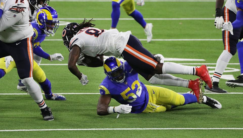 The Rams' Terrell Lewis (52) stops Chicago's Cordarrelle Patterson (84) short of a first down on a key fourth-down play.