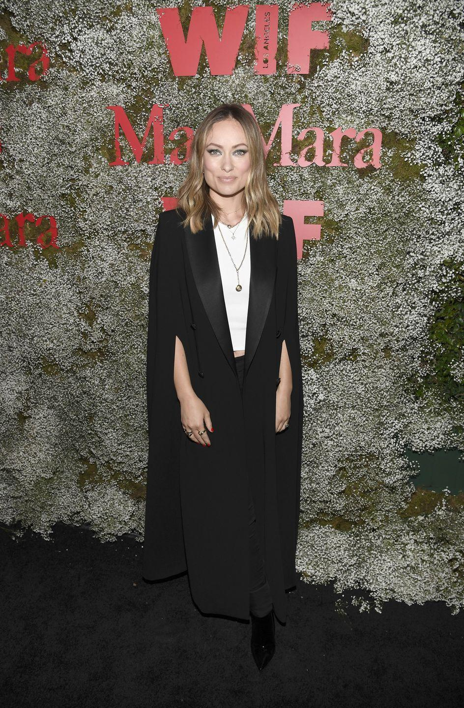 <p>The actress decked herself out in a black Max Mara cape jacket, a white T-shirt and black heeled boots at the Chateau Marmont-located event in Los Angeles. </p>