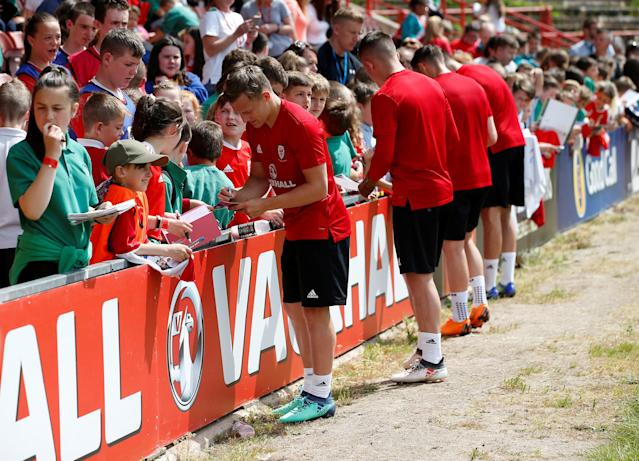 Soccer Football - Wales Training - The Racecourse, Wrexham, Britain - May 21, 2018 Wales players sign autographs for fans during training Action Images via Reuters/Craig Brough