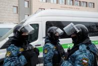 Law enforcement officers stand guard outside a court building in Moscow