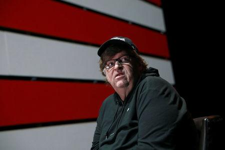 Michael Moore looks off stage during an interview at the site of his one-man Broadway show at the Belasco Theatre in Manhattan, New York, U.S., August 17, 2017.  REUTERS/Shannon Stapleton